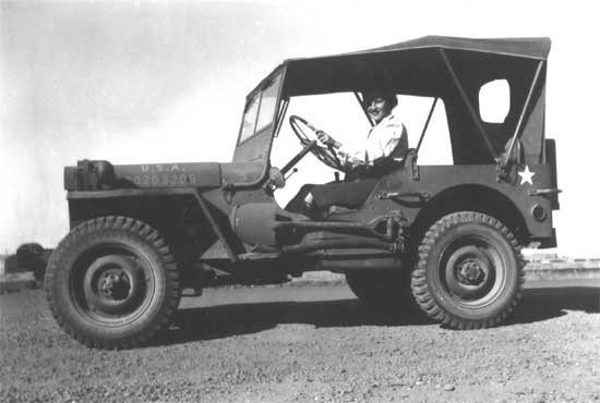 August 3, 1943. May Buelow Alm in a jeep ready to go to 104th Evacuation Hospital Headquarters.Waiting for a Driver