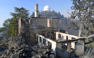 MOUNT HAMILTON, CA -AUGUST 20: A Lick Observatory building destroyed by the SCU Lightning Complex Fire is photographed atop Mount Hamilton, Calif., on Thursday, Aug. 20, 2020. The Observatory narrowly escaped being consumed by wildfire as fire crews worked overnight to beat back flames in the foothills above east San Jose. (Doug Duran/Bay Area News Group)